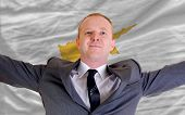 Happy Businessman Because Of Profitable Investment In Cyprus Standing Near Flag