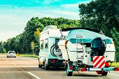 Rv Camper Car With Motor Boat On Road. Caravan And Motorhome In Trip In Switzerland. poster