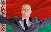 Happy Businessman Because Of Profitable Investment In Belarus Standing Near Flag