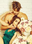 Sexy Couple Young Beautiful Cute Lovers In Love Pretty Girl And Sexi Man With Boxes Of Flowers Hug O poster
