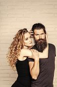 Man With Beard And Woman With Long Blond Hair. Fashion, Beauty, Style Concept. Couple In Love Hug On poster