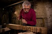 stock photo of woodcarving  - Old woodcarver work in the workshop 1 - JPG