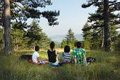 Family Hiking In Nature. Two Women Relaxes With Kids After A Walk In Nature. Family Enjoy Nature In  poster
