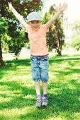 Funny Little Boy Jumps Outdoors. Happy And Healthy Childhood Concept. Cute Boy Playing In Summer Par poster