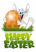 stock photo of happy easter  - Easter rabbit with Easter egg  - JPG