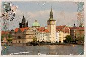 Background, stylized as vintage postcard, with a view of Prague.