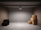 stock photo of garage  - Empty garage with metal roll up door - JPG