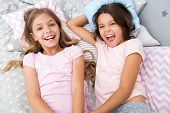 Pajama Party And Friendship. Pajama Party Of Two Happy Small Kids In Bedroom. Friendship Of Small Ki poster