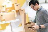 Young Asian Man Opening Cardboard Box Package. Packaging Design Product For Shopping Lifestyle Conce poster