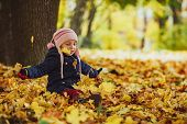 Family, Childhood, Fall Season And People Concept, Happy Girl Playing With Autumn Leaves In Park.lit poster