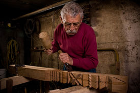 pic of woodcarving  - Old woodcarver work in the workshop 1 - JPG