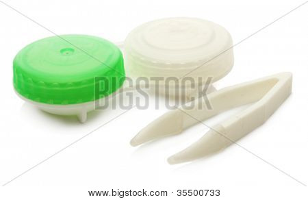 contact lenses in containers and tweezers isolated on white
