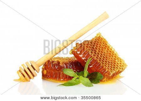 sweet honeycombs with mint and drizzler, isolated on white