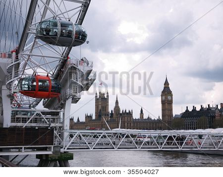 London Eye With Houses Of Parliament In The Background.
