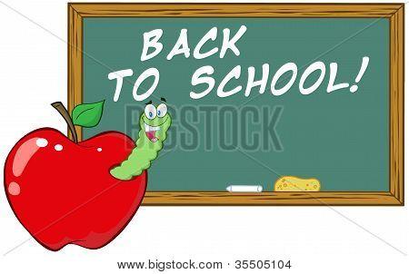 Worm In Apple In Front Of School Chalk Board