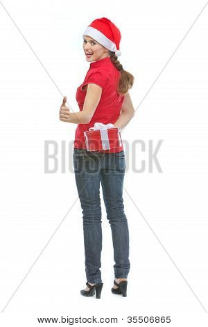 Happy Young Woman Hiding Christmas Present Box Behind Back And S