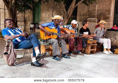 HAVANA-JULY 20:Unidentified men in a traditional music group playing for tourists July 20,2012 in Havana.The cuban music is an attraction for more than 2 million people who visit Cuba every year