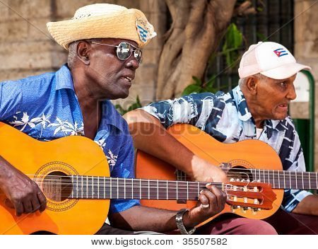 HAVANA-JULY 20:Unidentified musicians playing typical songs for tourists July 20,2012 in Havana.The cuban music and culture is an attraction for more than 2 million people who visit Cuba every year