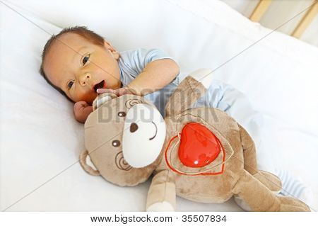 Newborn with bear toy