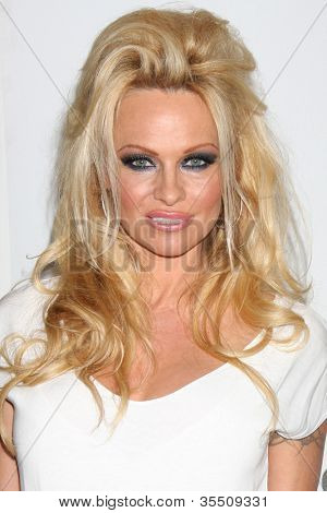 LOS ANGELES - JUL 27:  Pamela Anderson arrives at the ABC TCA Party Summer 2012 at Beverly Hilton Hotel on July 27, 2012 in Beverly Hills, CA