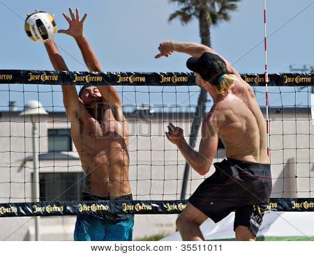 HERMOSA BEACH, CA - JULY 21: Matt Motter and Ty Tramblie compete in the Jose Cuervo Pro Beach Volleyball tournament in Hermosa Beach, CA on July 21, 2012.