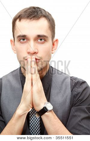 Portrait Of Young Confident Business Man Folds Hands Together On White Background