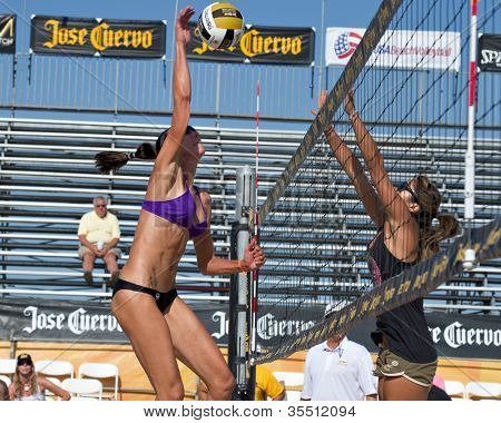 HERMOSA BEACH, CA - JULY 21: -Ashley Lee and Jenny Kropp compete in the Jose Cuervo Pro Beach Volleyball tournament in Hermosa Beach, CA on July 21, 2012.