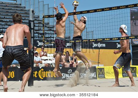 HERMOSA BEACH, CA - JULY 21: John Hyden, Sean Scott, Stein Metzger and Mark Williams  compete in the Jose Cuervo Pro Beach Volleyball tournament in Hermosa Beach, CA on July 21, 2012.