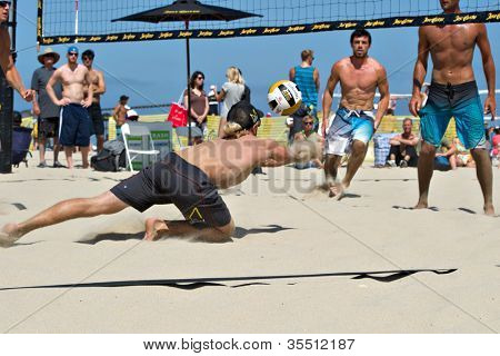 HERMOSA BEACH, CA - JULY 21: Derek Olson and Ty Tramblie compete in the Jose Cuervo Pro Beach Volleyball tournament in Hermosa Beach, CA on July 21, 2012.