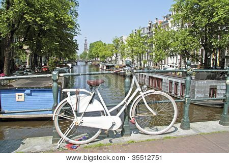 White bicycle in Amsterdam with the Westerkerk in the Netherlands