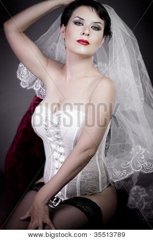 Beautiful bride with veil and white corset, underwear
