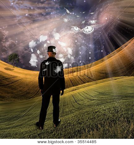 Business suited man with hat in dream landscape