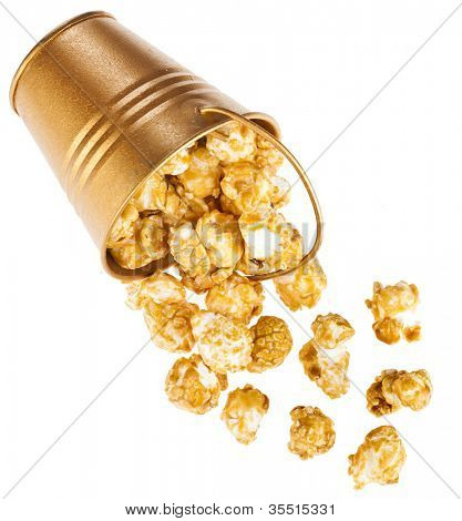 popcorn with caramel  in a bucket box isolated on white