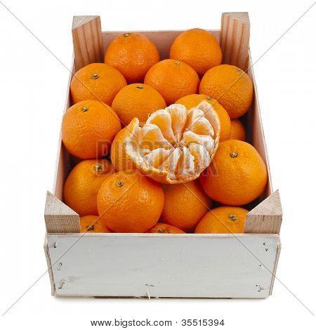 ripe orange mandarines in wooden box crate isolated on white