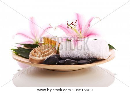Plate with some inventory for massage over whtie background