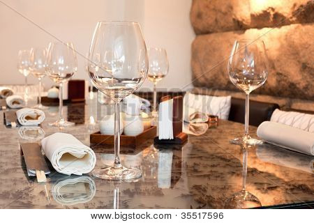 Glasses on table in sushi restaurant, focus on glass
