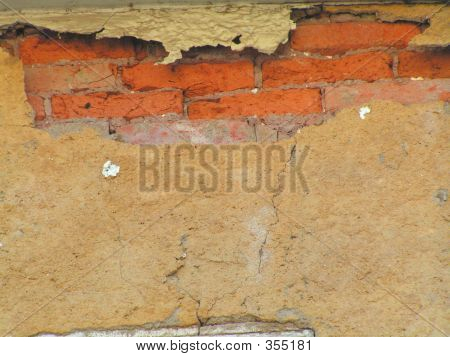 Cracked And Broken Stucco Wall