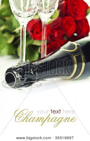 Romantic still life with champagne and beautiful red roses over white (with easy removable text)