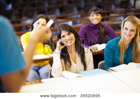 college professor lecturing group of students in classroom