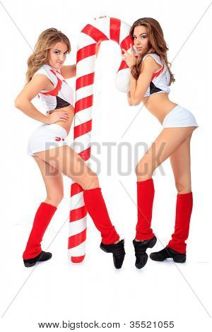 Two professional cheerleaders posing at studio. Isolated over white.