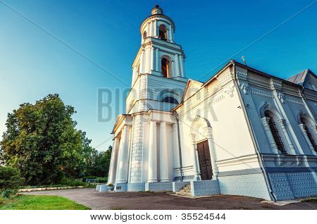Old russian church under blue sky. fisheye lens