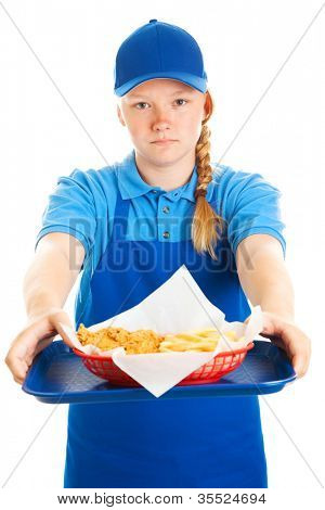 Serious teenage girl serving a fast food meal.  Isolated on white.