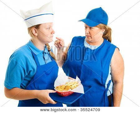 Teen girl working in fast food gets pushed around by her boss.  Isolated on white.