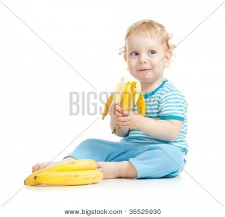 happy child eating healthy food fruits isolated on white