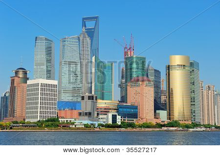 Shanghai urban skyline with blue clear sky over Huangpu River.
