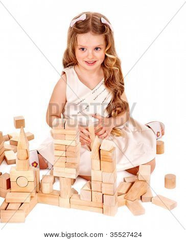Happy child play building blocks. Isolated.