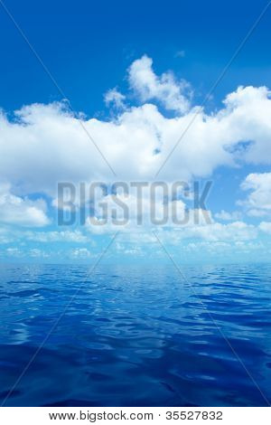 Blue calm sea water in offshore ocean with clouds mirror surface