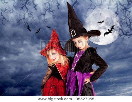 halloween costumes kid girls on moon night sky with bats [photo-illustration]
