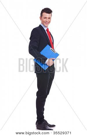 full body portrait of a young business man with a blue clipboard over white background