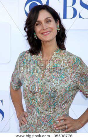 LOS ANGELES - JUL 29:  Carrie-Anne Moss arrives at the CBS, CW, and Showtime 2012 Summer TCA party at Beverly Hilton Hotel Adjacent Parking Lot on July 29, 2012 in Beverly Hills, CA